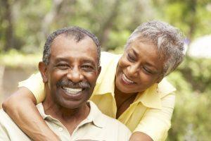 bigstock-Senior-Couple-Outdoors-Hugging-13907525